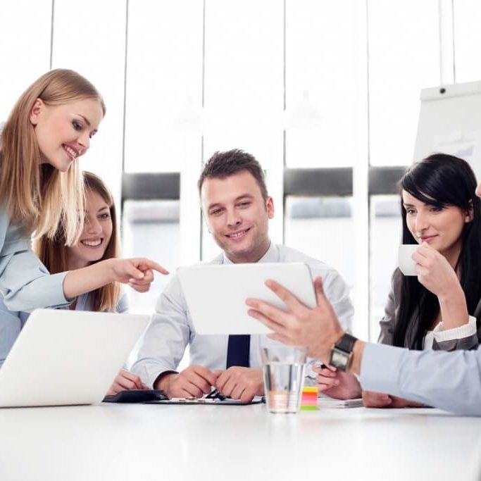 Group of business people working with digital tablet in office